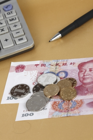 Calculator and chinese currency Stock Photo - 17938182
