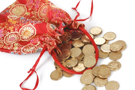 red bags full of golden coins  isolated on white  Stock Photo - 17938184