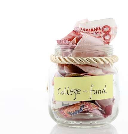 A lot of money in a glass bottle labeled  College fund Stock Photo - 17938155