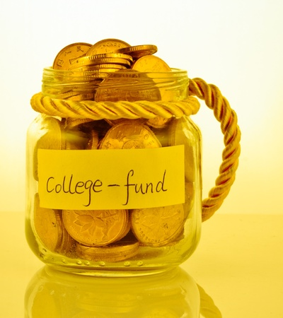 A lot of money in a glass bottle labeled  College fund Stock Photo - 17938168