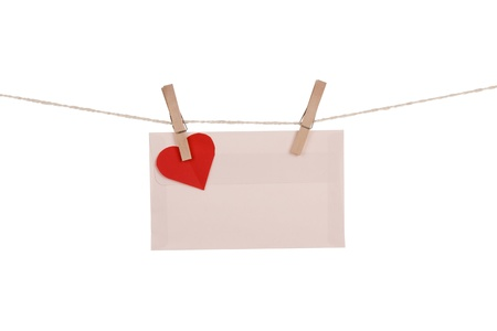 Blank paper cards hanging on clothespins photo