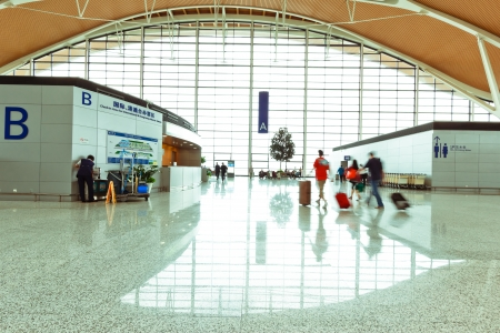 shiny floor: interior of the modern architectural in shanghai airport. Editorial