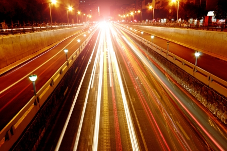beautiful light trail at the busy highway
