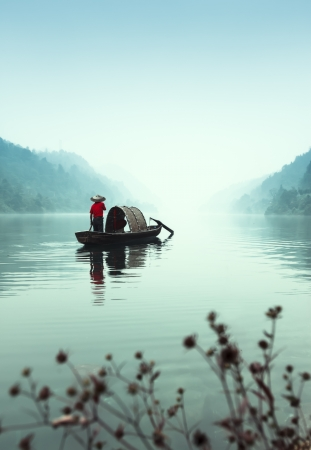 Small beautiful Dongjiang River landscape, the fishermen 写真素材