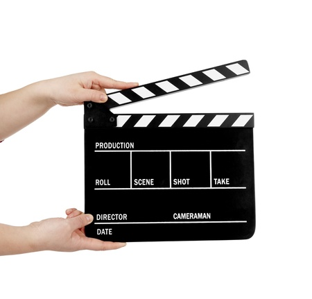 human hand holding a movie clapboard photo