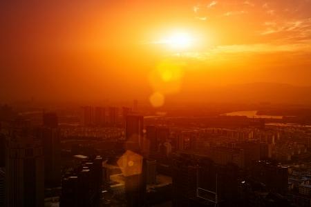 Dramatic scenery sunset of the city center Standard-Bild