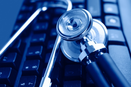 Stethoscope and keyboard illustrating concept of digital security Stockfoto