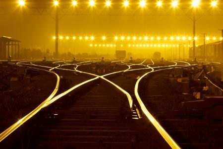 Cargo train platform at sunset with container Standard-Bild