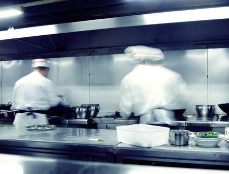 motion chefs of a restaurant kitchen photo