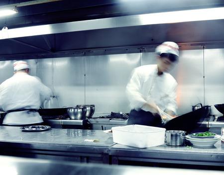 Motion koks van een restaurant keuken Stockfoto