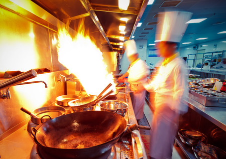 busy restaurant: motion chefs in a restaurant kitchen