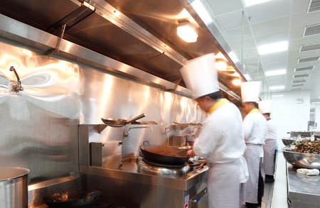 motion chefs in a restaurant kitchen photo