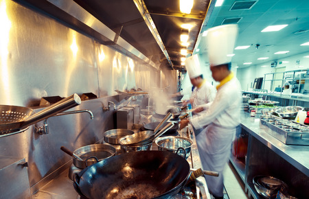 motion chefs in a restaurant kitchen