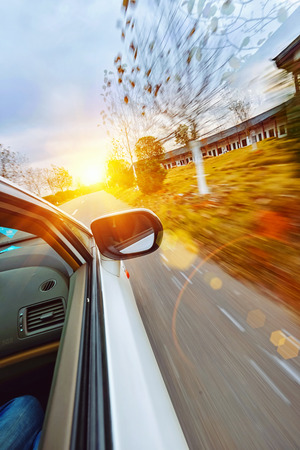 A car driving on a motorway at high speeds, photo