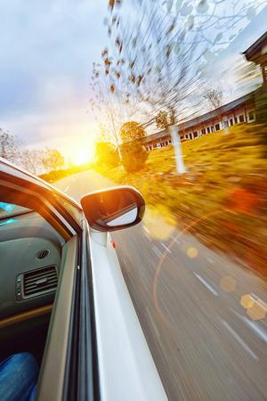 A car driving on a motorway at high speeds, Standard-Bild
