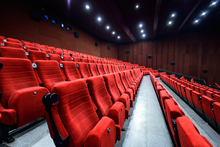 theater seat: Empty movie theater with red seats Editorial