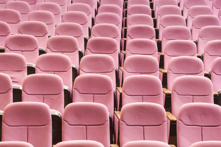 Empty movie theater with red seats Stock Photo