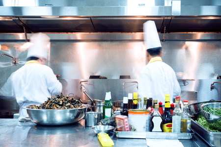 in action: motion chefs of a restaurant kitchen