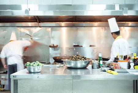 kitchen counter top: motion chefs of a restaurant kitchen