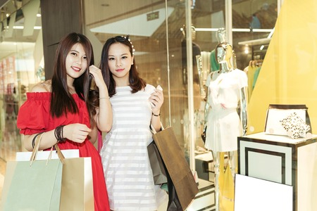 Beautiful young women shopping in a clothing store