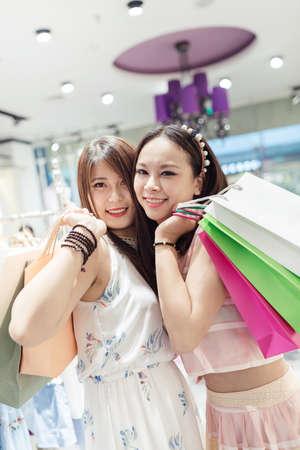 Beautiful young women shopping in a clothing store photo