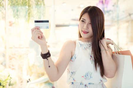 clothing store: Beautiful young women shopping in a clothing store