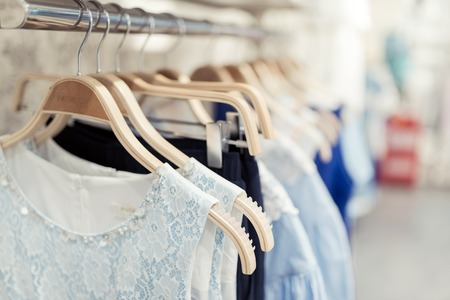 Shop with different clothes shopping, racks and shelves Redactioneel