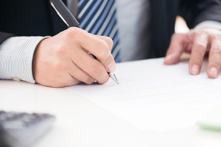 businesswear: Close up of businessman signing a contract