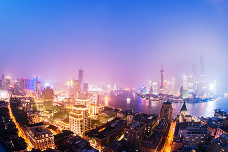 night shanghai skyline with reflection ,beautiful modern city