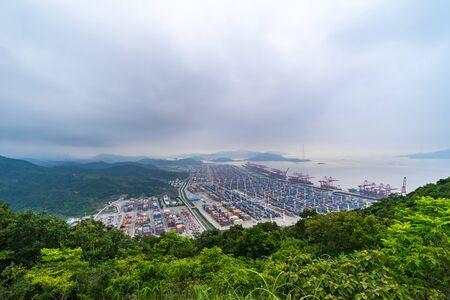 shanghai container terminal at dusk ,yangshan deep-water port , China Standard-Bild