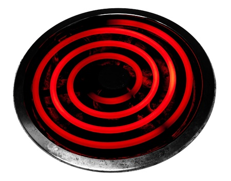 Glowing electric stove burner head spiral. photo