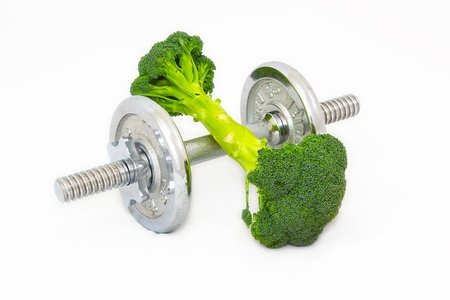 Dumbell made of Broccoli on white background. Banco de Imagens