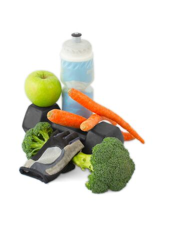 Dumbbells made of broccoli with water bottle, carrots, glove and green apple Banco de Imagens
