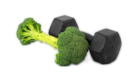 Dumbells made of broccoli on white background