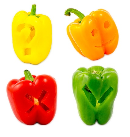 A mix of differently colored bell peppers isolated on white background. photo