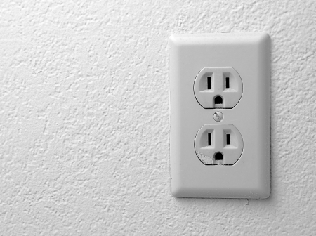Electric outlet on the texturazed wallpapers.