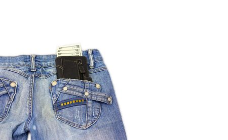 Black laether wallet sticking out of jeans pocket photo