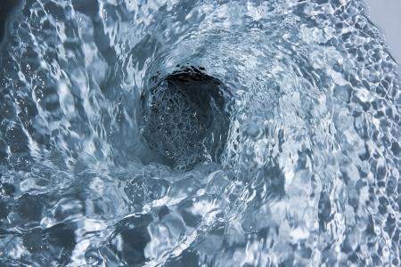 Toilet bowl flush. Close up.