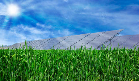 Solar panel on green grass and blue cloudy sky  photo