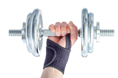 resist: Wrist damage rehabilitation. Hand in brace holding metal dumbbell