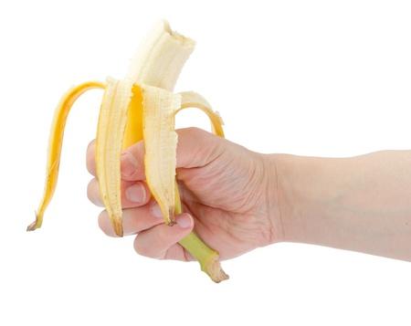 Hand holding eaten banana. Isolated on white.