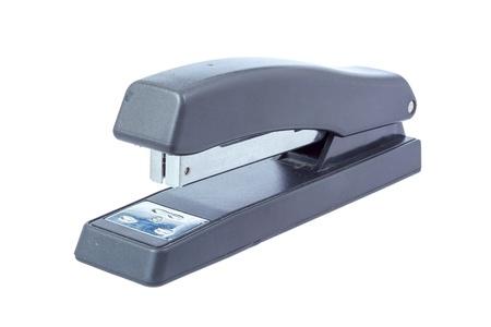 office stapler: Black office stapler isolated on white background.