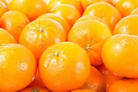 Many mandarines oranges in storage box