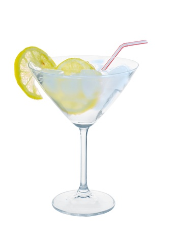 Citrus in martini glass with ice isolated on white background photo