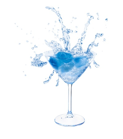 martini splash: Intense blue ice splashing in martini glass isolated on white background  Stock Photo