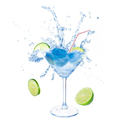 Lime splashing in martini glass with intense blue ice  Isolated on white background  photo