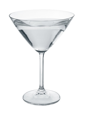 Martini glass filled with transparent colorless liquid isolated on white   photo