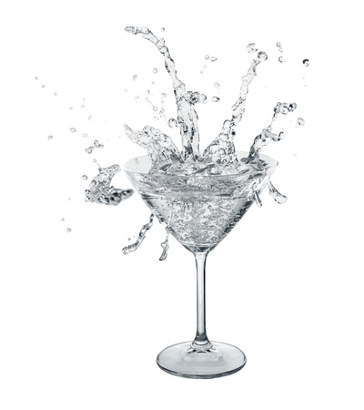 martini splash: Neutral color water slashes in martini glass  Isolated on white