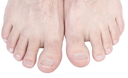 human toe: Caucasian male toes isolated on white background.