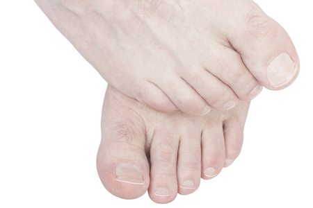 Caucasian male foot rubbing another foot isolated on white background. photo